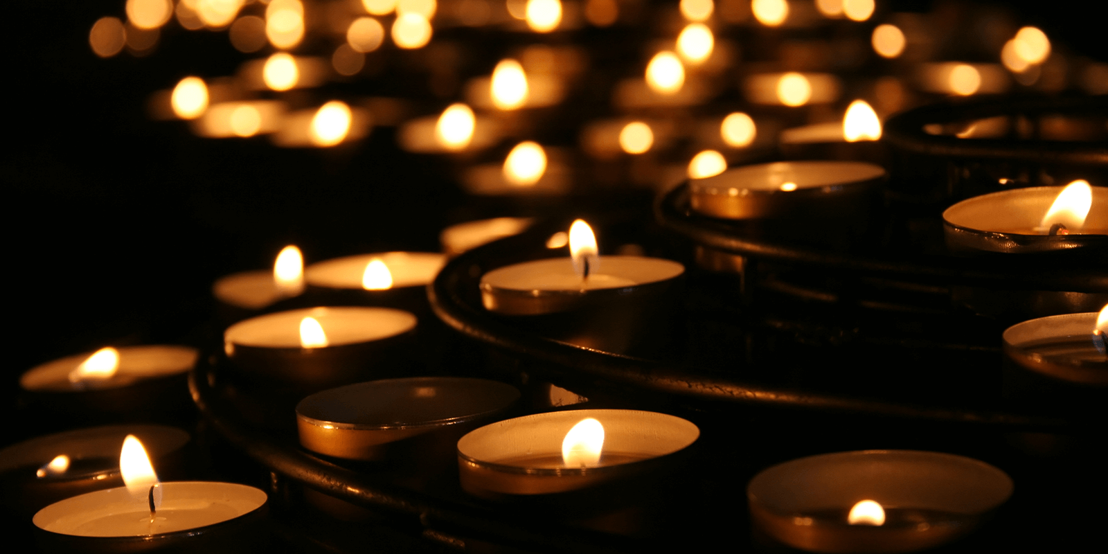 Collection lighted of votive candles for Workers Memorial Day